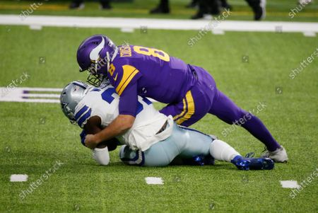 Dallas Cowboys safety Donovan Wilson recovers a fumble by Minnesota Vikings quarterback Kirk Cousins, right, during the first half of an NFL football game, in Minneapolis