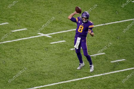 Minnesota Vikings quarterback Kirk Cousins throws a pass during the second half of an NFL football game against the Dallas Cowboys, in Minneapolis