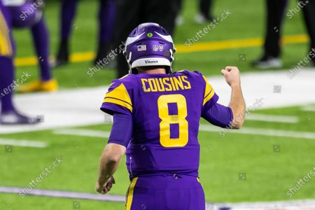 Minnesota Vikings quarterback Kirk Cousins (8) celebrates after throwing a pass for a touchdown in the fourth quarter during an NFL football game against the Dallas Cowboys, in Minneapolis