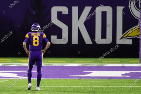 Minnesota Vikings quarterback Kirk Cousins (8) looks on in the third quarter during an NFL football game against the Dallas Cowboys, in Minneapolis