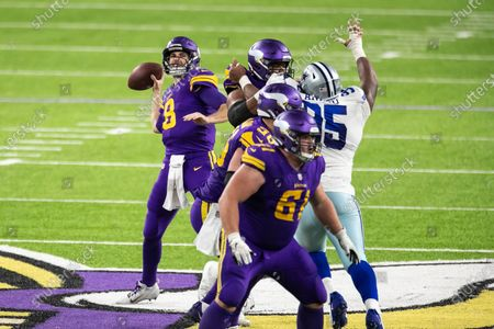 Minnesota Vikings quarterback Kirk Cousins (8) throws a pass in the fourth quarter during an NFL football game against the Dallas Cowboys, in Minneapolis