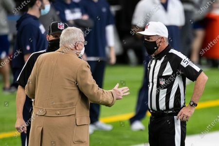 Stock Image of Dallas Cowboys owner Jerry Jones, left, talks to referee Bill Vinovich (52) before the start of an NFL football game against the Minnesota Vikings, in Minneapolis