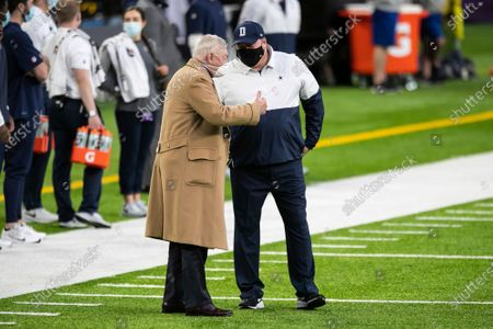 Dallas Cowboys owner Jerry Jones, left, talks to head coach Mike McCarthy before the start of an NFL football game against the Minnesota Vikings, in Minneapolis