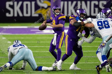 Minnesota Vikings quarterback Kirk Cousins (8) passes the ball in the second quarter during an NFL football game against the Dallas Cowboys, in Minneapolis