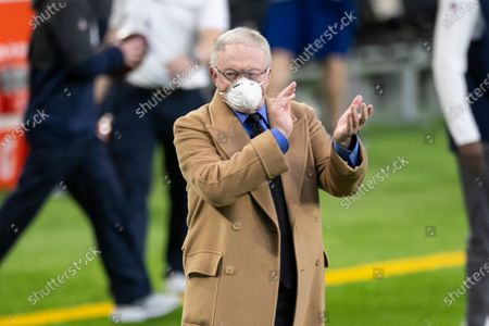 Stock Picture of Dallas Cowboys owner Jerry Jones cheers before the start of an NFL football game against the Minnesota Vikings, in Minneapolis