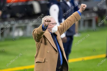 Dallas Cowboys owner Jerry Jones cheers before the start of an NFL football game against the Minnesota Vikings, in Minneapolis