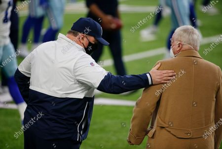 Dallas Cowboys head coach Mike McCarthy, left, talks with Cowboys owner Jerry Jones before an NFL football game against the Minnesota Vikings, in Minneapolis