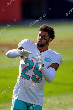 Stock Image of Miami Dolphins safety Brandon Jones (29) warms up against the Denver Broncos before an an NFL football game, in Denver