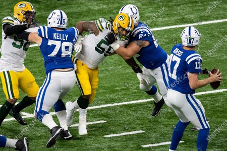 Green Bay Packers linebacker Za'Darius Smith (55) rushes between Indianapolis Colts guard Mark Glowinski (64) and Indianapolis Colts center Ryan Kelly (78) during an NFL football game, in Indianapolis