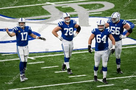 Indianapolis Colts quarterback Philip Rivers (17) walks to the huddle with Indianapolis Colts center Ryan Kelly (78), Indianapolis Colts guard Mark Glowinski (64) and Indianapolis Colts guard Quenton Nelson (56) during an NFL football game, in Indianapolis
