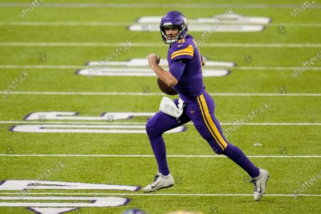 Minnesota Vikings quarterback Kirk Cousins (8) looks to pass during the first half of an NFL football game against the Dallas Cowboys, in Minneapolis