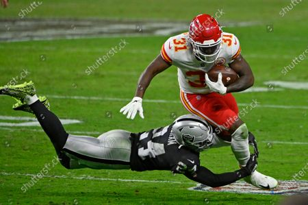 Las Vegas Raiders strong safety Johnathan Abram (24) tackles Kansas City Chiefs running back Darrel Williams (31) during the second half of an NFL football game, in Las Vegas