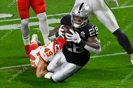 Stock Photo of Kansas City Chiefs free safety Daniel Sorensen (49) tackles Las Vegas Raiders running back Josh Jacobs (28) during the first half of an NFL football game, in Las Vegas