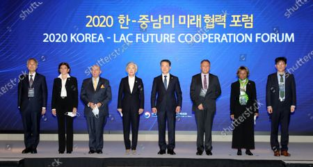 South Korean Foreign Minister Kang Kyung-wha (4-L), Health Minister Park Neunghoo (4-R) and other participants join a group photo session at a hotel in Seoul, South Korea, 23 November 2020, during a forum on future cooperation between South Korea and countries in South and Central America.