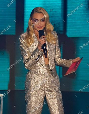 Cara Delevigne presents the award for favorite pop/rock song at the American Music Awards, at the Microsoft Theater in Los Angeles