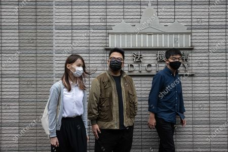 Agnes Chow Ting (L), Ivan Lam Long Ying (C), and Joshua Wong Chi-fung (R) arrive at the West Kowloon Law Courts building in Hong Kong, China, 23 November 2020. The three pro-democracy activists are being charged for incitement to knowingly take part in an unauthorised assembly, organising an unauthorised assembly and knowingly taking part in an unauthorised assembly, all related to a rally on 25 June 2020.