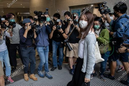 Pro-democracy activist Agnes Chow Ting, (R), arrives at the West Kowloon Law Courts building in Hong Kong, China, 23 November 2020. Three pro-democracy including Chow, Joshua Wong and Ivan Lam are being charged for incitement to knowingly take part in an unauthorised assembly, organising an unauthorised assembly and knowingly taking part in an unauthorised assembly.
