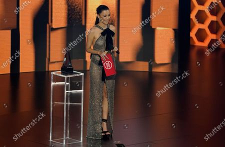 Christian Serratos presents the award for favorite latin album at the American Music Awards, at the Microsoft Theater in Los Angeles
