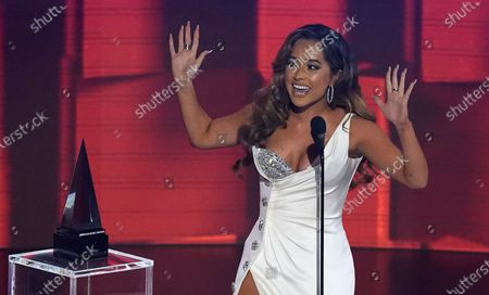Becky G accepts the award for favorite latin female artist at the American Music Awards, at the Microsoft Theater in Los Angeles