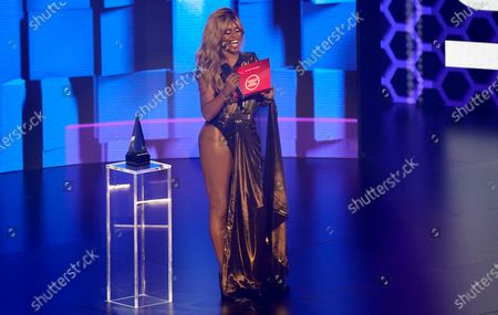 Laverne Cox presents the award for favorite rap/hip-hop song at the American Music Awards, at the Microsoft Theater in Los Angeles