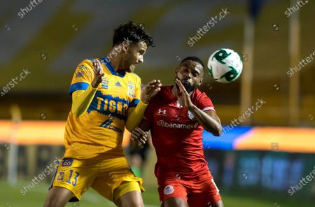 Diego Reyes (L) of Tigres UANL in action against William Da Silva (R) of Toluca during the Liga MX repechage match for the 2020 Guard1anes Tournament between Tigres UANL and Toluca at the University Stadium in San Nicolas de los Garza, Mexico, 22 November 2020.