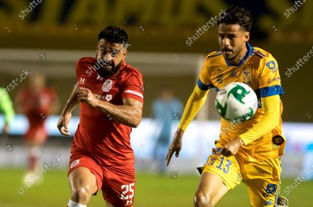 Diego Reyes (R) of Tigres UANL in action against Alexis Canelo (L) of Toluca during the Liga MX repechage match for the 2020 Guard1anes Tournament between Tigres UANL and Toluca at the University Stadium in San Nicolas de los Garza, Mexico, 22 November 2020.
