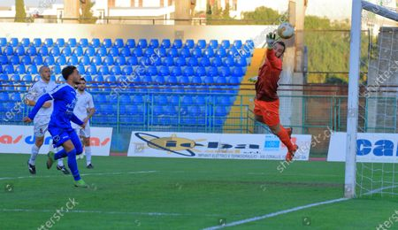 Pagani,Sa,Italy : November 22,2020 :Serie C 2020/2021 Pro League   Football Championship Twelfth day : Paganese Vs Bisceglie 1 - 1 Giuseppe Guadagni , (26) striker Paganese pulls ball towards goal defense by Andrea Spurio , (22) goalkeeper of Bisceglie