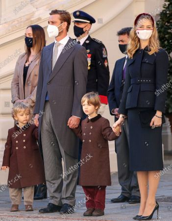 From the left, Francesco Casiraghi, Pierre Casiraghi, Stephano Casiraghi and Beatrice Borromeo attend the celebrations marking Monaco's National Day at the Palace in Monaco