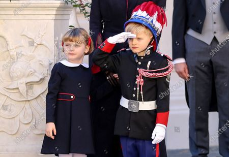 Prince Jacques of Monaco salutes next to Princess Gabriella of Monaco during the celebrations marking Monaco's National Day at the Palace in Monaco