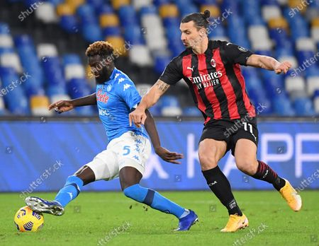 AC Milan's Zlatan Ibrahimovic (R) vies with Napoli's Tiemoue Bakayoko during a Serie A football match between Napoli and AC Milan in Naples, Italy, Nov. 22, 2020.