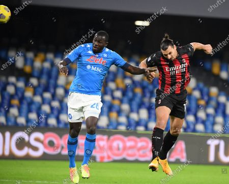 AC Milan's Zlatan Ibrahimovic (R) scores during a Serie A football match between Napoli and AC Milan in Naples, Italy, Nov. 22, 2020.