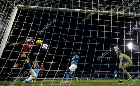 AC Milan's Zlatan Ibrahimovic (1st L) scores during a Serie A football match between Napoli and AC Milan in Naples, Italy, Nov. 22, 2020.