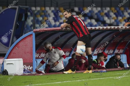 AC Milan's Swedish forward Zlatan Ibrahimovic is next of his side's bench after sustaining an injury during the Serie A football match SSC Napoli vs AC Milan. AC Milan won 3-1.