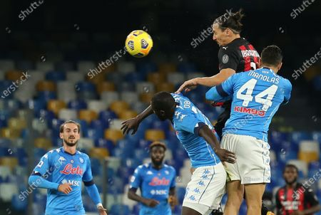 Stock Image of AC Milan's Swedish forward Zlatan Ibrahimovic heads the ball during the Serie A football match SSC Napoli vs AC Milan. AC Milan won 3-1.