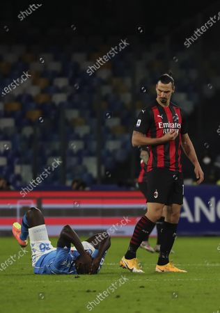 Stock Picture of Napoli's Senegalese defender Kalidou Koulibaly lies on the ground after fighting with AC Milan's Swedish forward Zlatan Ibrahimovic during the Serie A football match SSC Napoli vs AC Milan. AC Milan won 3-1.