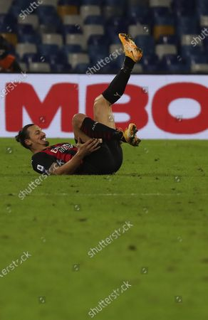 AC Milan's Swedish forward Zlatan Ibrahimovic lies on the ground after sustaining an injury during the Serie A football match SSC Napoli vs AC Milan. AC Milan won 3-1.