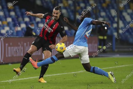 AC Milan's Swedish forward Zlatan Ibrahimovic fights for the ball with Napoli's Senegalese defender Kalidou Koulibaly during the Serie A football match SSC Napoli vs AC Milan. AC Milan won 3-1.