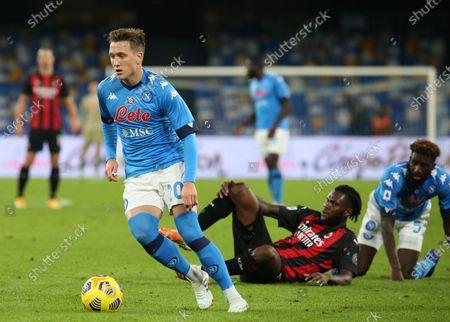 Stock Image of Napoli's Polish midfielder Piotr Zielinski controls the ball during the Serie A football match SSC Napoli vs AC Milan. AC Milan won 3-1.