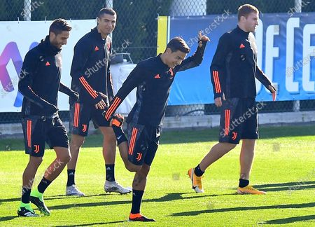 Juventus players (L-R) Rodrigo Bentancur, Cristiano Ronaldo, Paulo Dybala, and Dejan Kulusevski attend their team's training session at Continassa Centre in Turin, Italy, 23 November 2020. Juventus FC will face Ferencvaros in their UEFA Champions League group G soccer match on 24 November 2020.