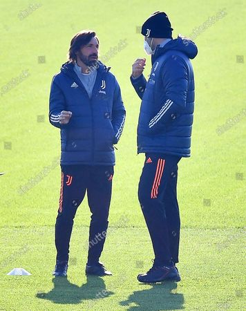 Juventus' head coach Andrea Pirlo (L) and his assistant Igor Tudor (R) lead their team's training session at Continassa Centre in Turin, Italy, 23 November 2020. Juventus FC will face Ferencvaros in their UEFA Champions League group G soccer match on 24 November 2020.