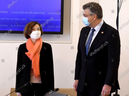 Croatian Prime Minister Andrej Plenkovic (R) poses with welcoming to the French Defence Minister Florence Parly (L)  during her one-day visiting to the Croatian capital, Zagreb, 23 November 2020. Croatia negotiates with several countries about buying military hunter aircrafts.