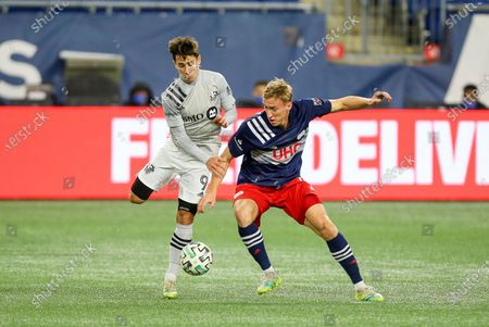 Stock Picture of Montreal Impact forward Bojan Krkic (9) and New England Revolution forward Adam Buksa (9) battle for the ball during the first half of an MLS soccer match, in Foxborough, Mass