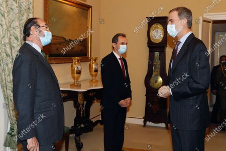A handout photo made available by the Spanish Royal Household shows King Felipe VI of Spain (R) arriving to chair a meeting of the Scientific Council of the Elcano Royal Institute in Madrid, Spain, 23 November 2020.