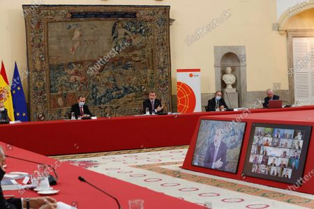 A handout photo made available by the Spanish Royal Household shows King Felipe VI of Spain (3-R) chairing a meeting of the Scientific Council of the Elcano Royal Institute in Madrid, Spain, 23 November 2020.