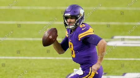 Stock Photo of Minnesota Vikings quarterback Kirk Cousins (8) looks for a reliever during an NFL football game against the Dallas Cowboys, in Minneapolis