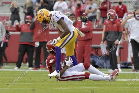 Stock Photo of Defensive back Eli Ricks (1) reacts after a tackle against Arkansas during an NCAA college football game, in Fayetteville, Ark. Ricks was penalized for targeting and ejected from the game as a result of the play