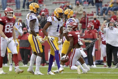 Stock Image of Defensive back Eli Ricks (1) reacts after a tackle against Arkansas during an NCAA college football game, in Fayetteville, Ark. Ricks was penalized for targeting and ejected from the game as a result of the play