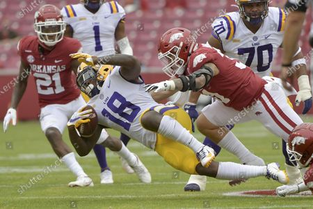 Stock Image of Running back Chris Curry (18) spins away from Arkansas defender Grant Morgan (31) during the first half of an NCAA college football game, in Fayetteville, Ark