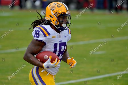 LSU's Chris Curry warms up before playing Arkansas during an NCAA college football game, in Fayetteville, Ark