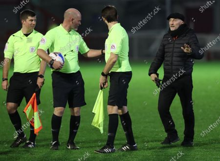 Grimsby manager  Ian Holloway has words with the referee Kevin Johnson after the SkyBet League Two match between Crawley Town and Grimsby Town at the People's Pension Stadium in Crawley. 24 November 2020.